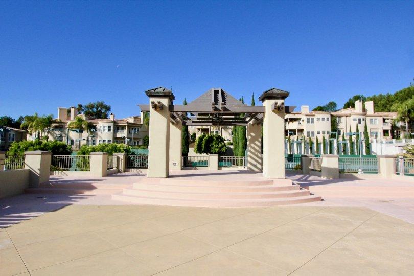 A pathway leading to a pool in Marbella Golf Villas in San Juan Capistrano, CA