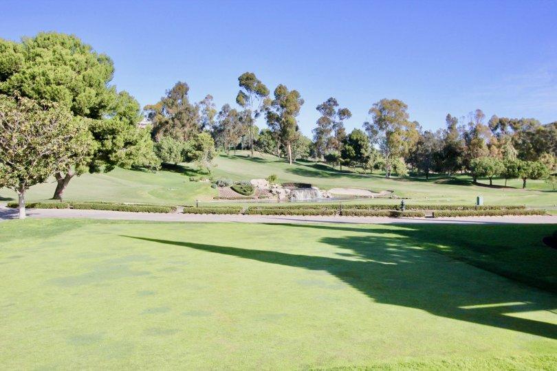 A sidewalk flows through the golf course at the Marbella Golf Villas