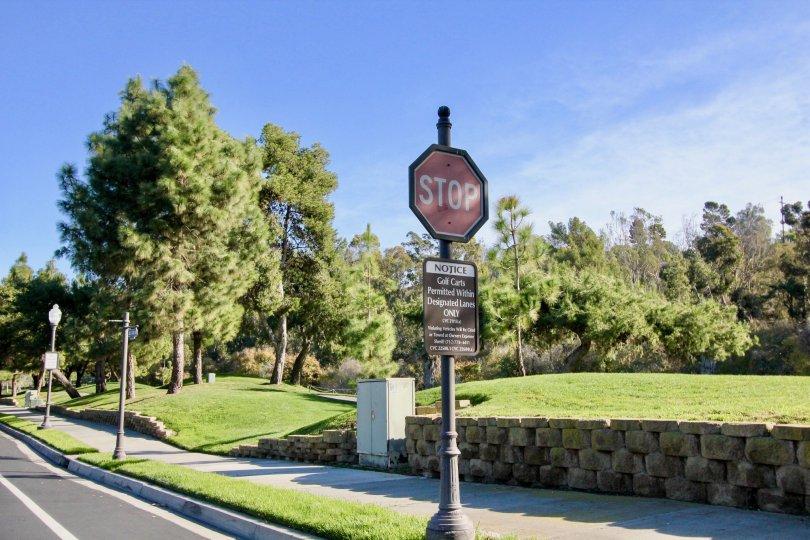 Sidewalk and sign at Marbella Golf Villas in San Juan Capistrano, CA