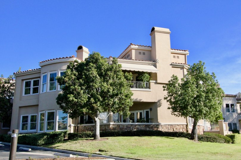 An ornate and decorative condo building sits on a corner at the Marbella Golf Villas