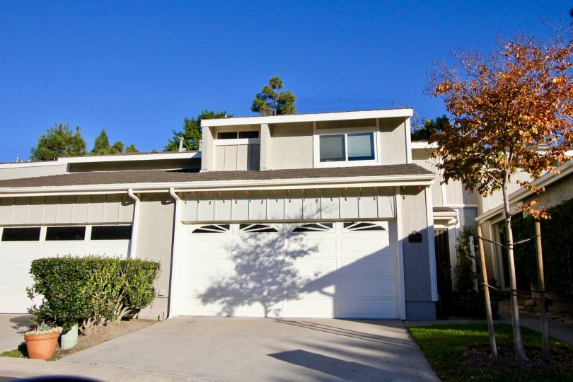 A pale grey home with a garage in Mariners Village community in San Juan Capistrano, California.