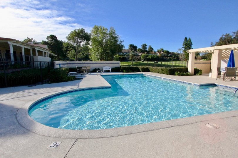 mesa verde community pool with sun deck and lounge chairs to relax