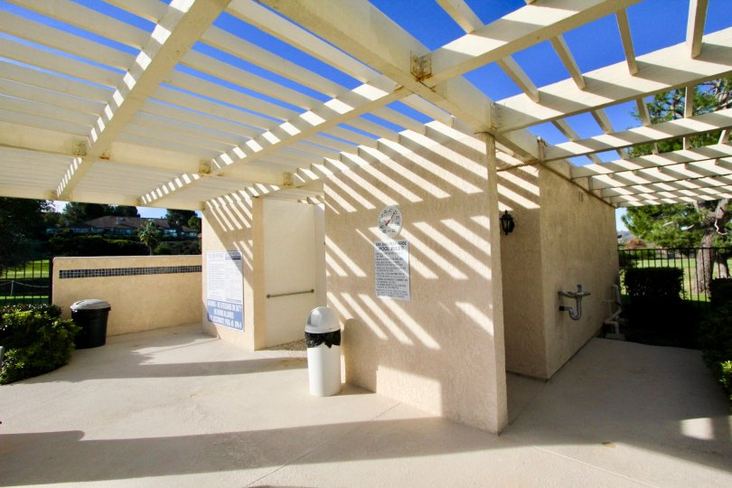 A white wood bathroom outside in Mesa Verde community in San Juan Capistrano, California.