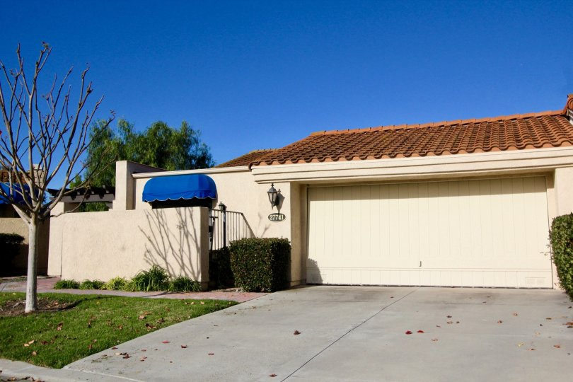 Two car garages with secluded patio area in this Mesa Verde community unit