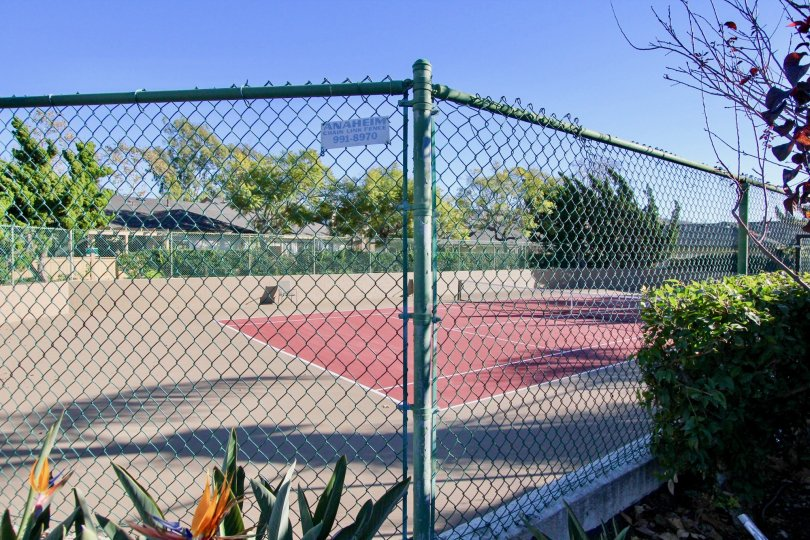 Fence surrounding a tennis court in Mission Point.
