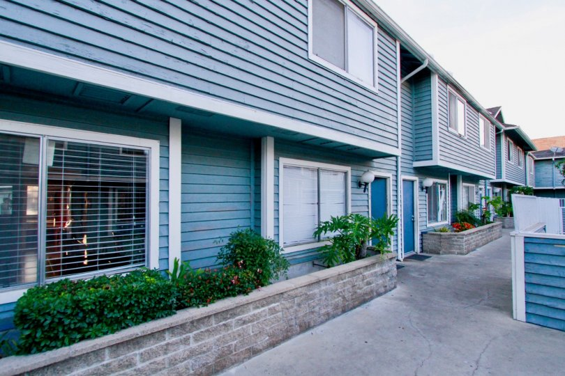 Friendly blue two story townhomes inside the Brightwood Square community in Santa Ana CA