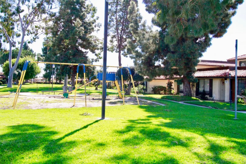 Playground outside beautiful home with trees in Corscican Village, Santa Ana CA