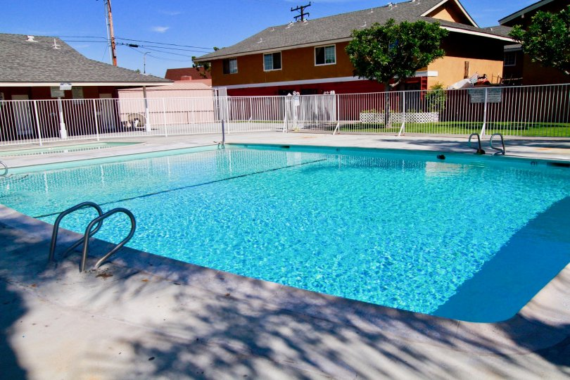 Gated swimming pool with kids pool in Fairlane Gardens community, Santa Ana, CA.