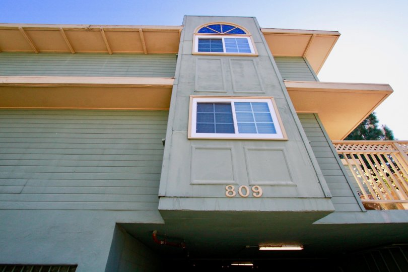 A close up view of building number 809 with a side balcony in the Heritage Park Place community