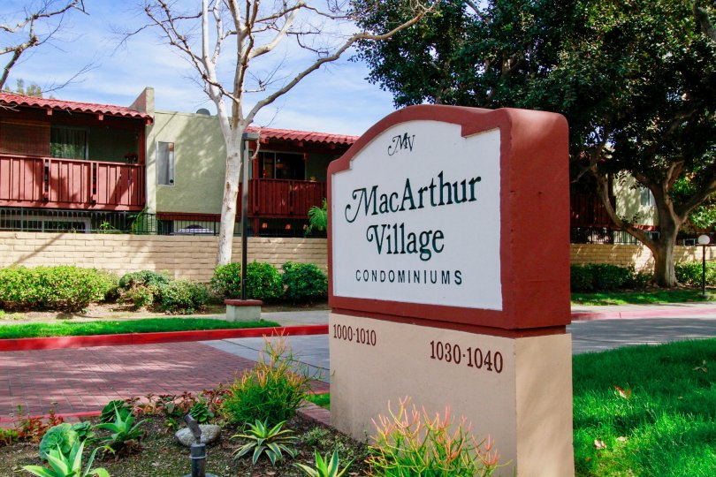 wall haveing lettesw MacArthur Village in MacArthur Village