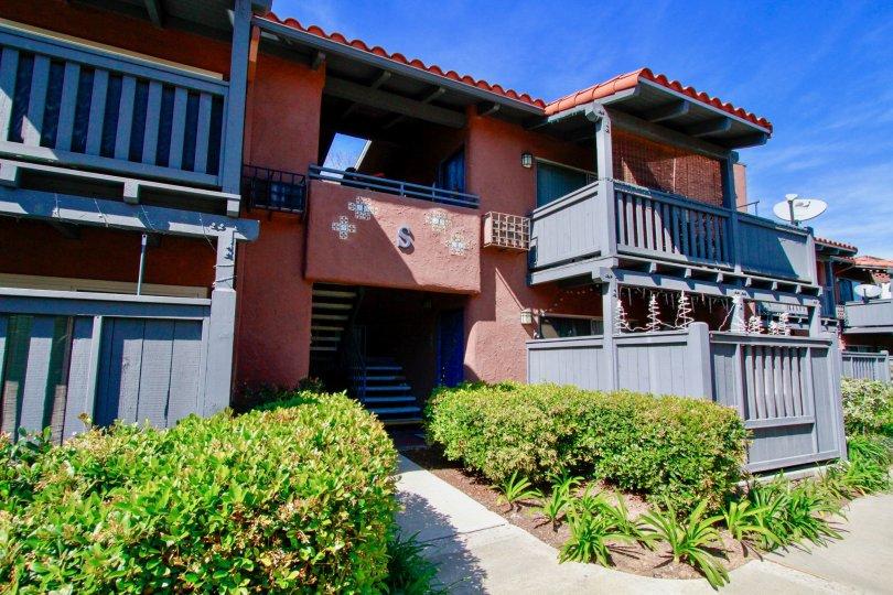 Exterior of the Monterey Villas building on a sunny day in Santa Ana, California