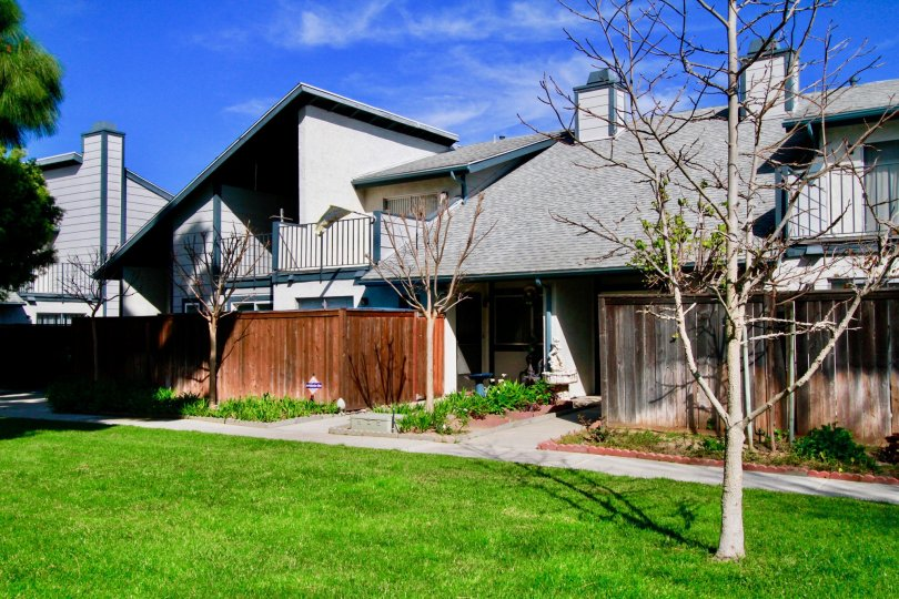 An architectural beauty with sloped roof with a lawn in the Mountain view community in Santa Ana