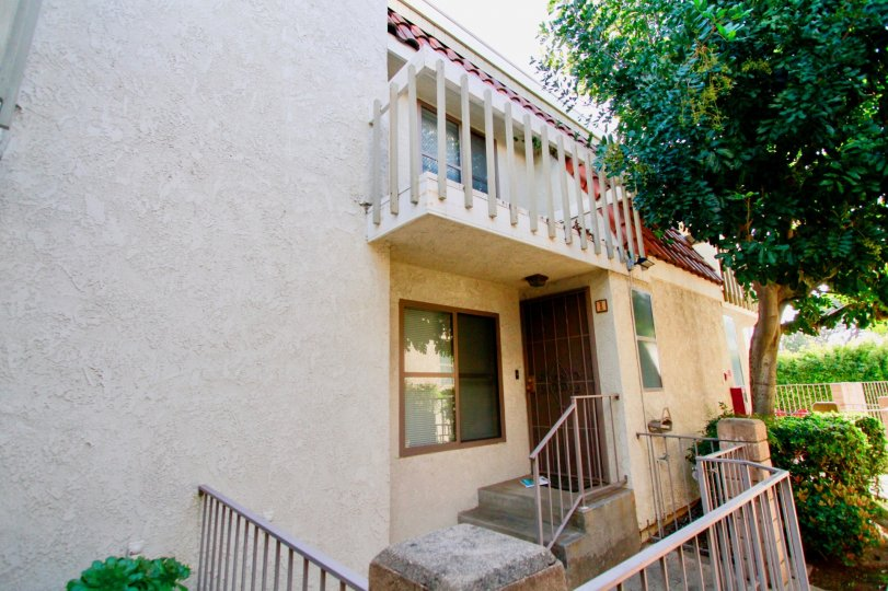 A house in Santa Ana, California with the front door and 2 floor balcony visible