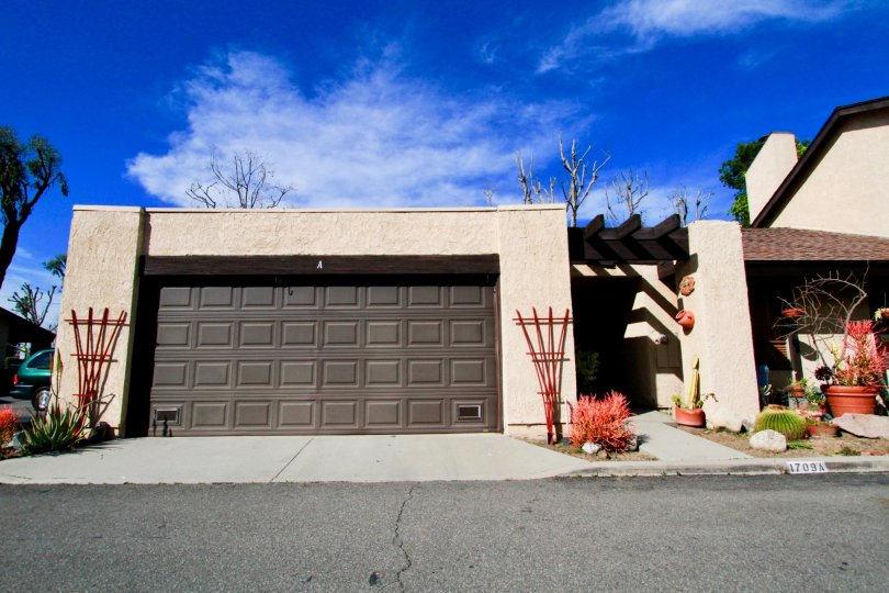 A view of a large garage door of an elegantly built bunglow in the Park Glen community