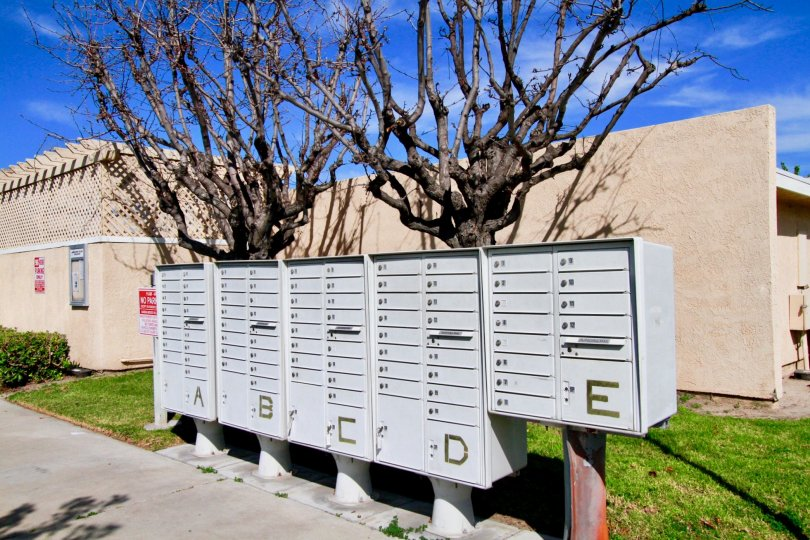 Many postal boxes are fixed at the pathway in Sandalwood Village which is named by alphabets