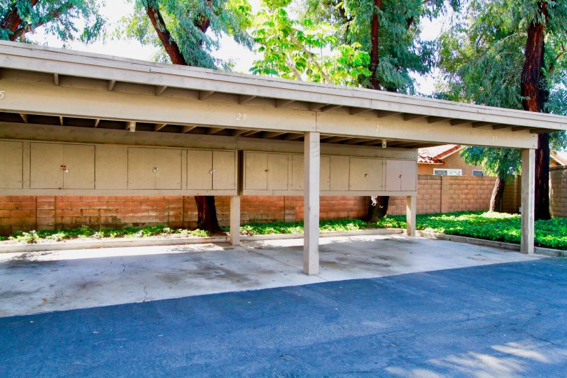 Car shelter with storage cabinets for the Santiago Springs community in Santa Ana, California