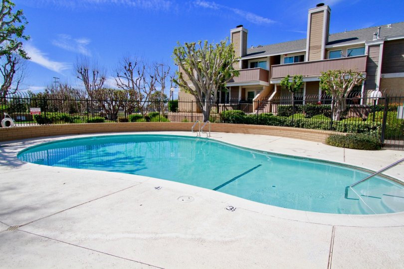 A lovely pool opposite a large bunglow with garden in the Santiago Springs community
