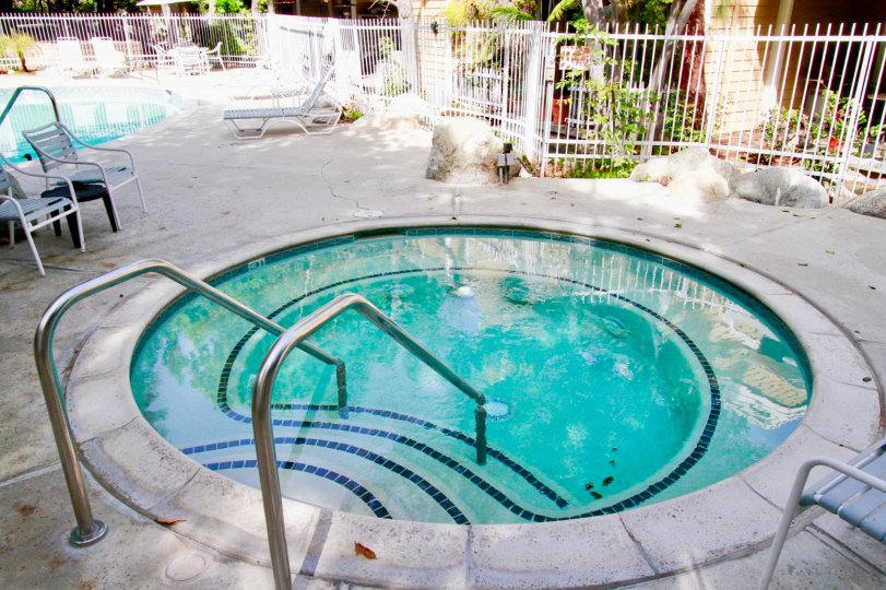 Children swimming pool is available in the apartment of South Coast Springs with trees and chairs