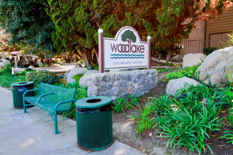 Woodlake Santa Ana California resembles as park for children with different green shades in trees, benches, leafs