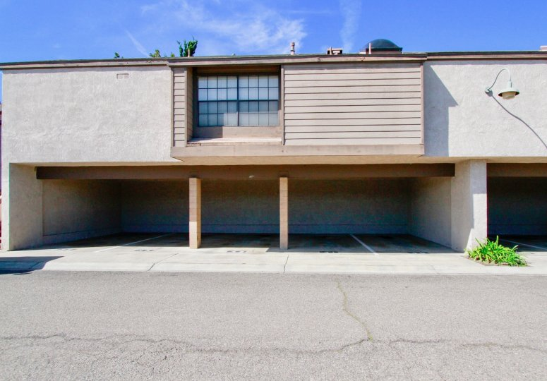 Under the Villa in Woodlake, parking facilities is available and light lamp is hanger in the wall