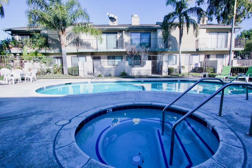 THE APARTMENT IN THE CERRITOS GARDENS WITH THE SWIMMING POOL, TABLES, BALCONIS