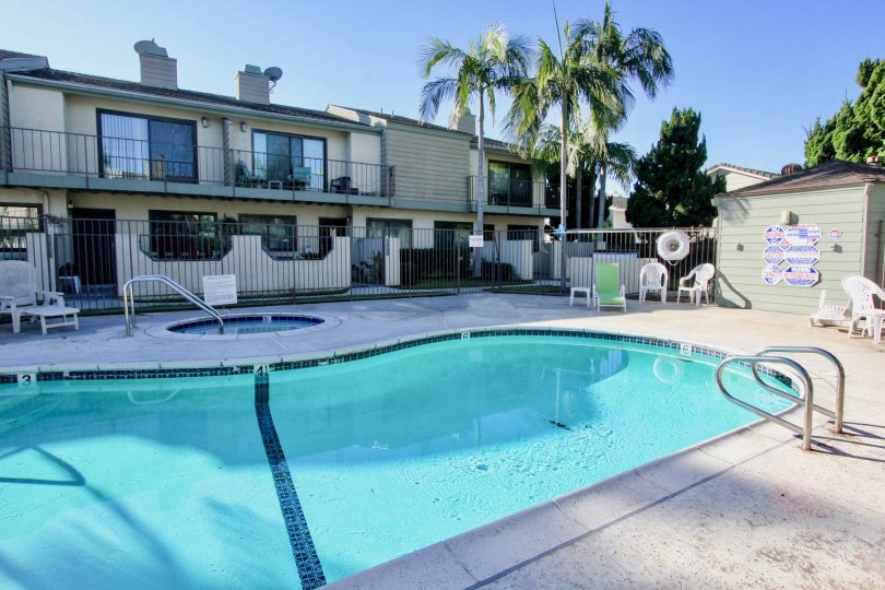 A view of the apartment complex community area of Cerritos Gardens focused on its pool and jacuzzi