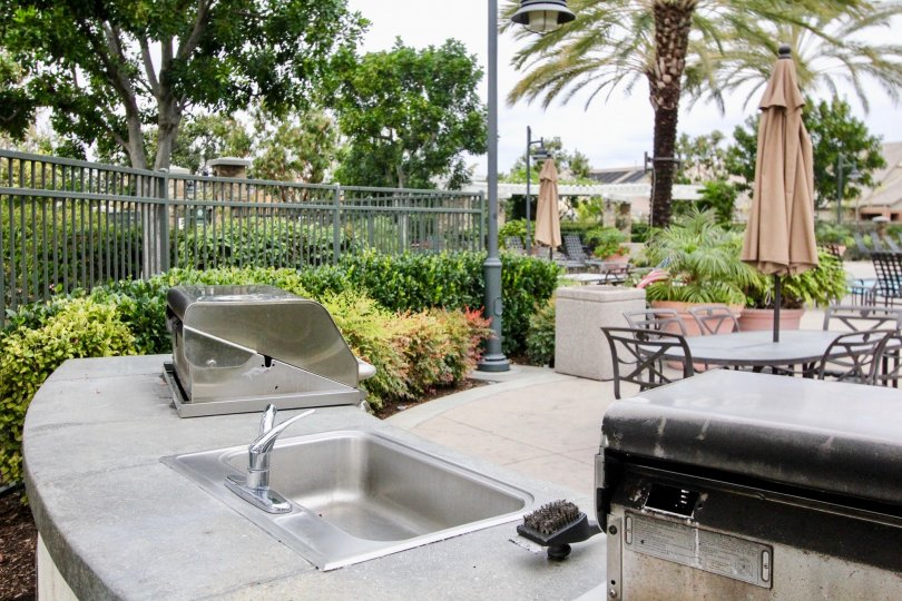 Common area pool with BBQ and outdoor cooking facilities at the Ainsley Park community