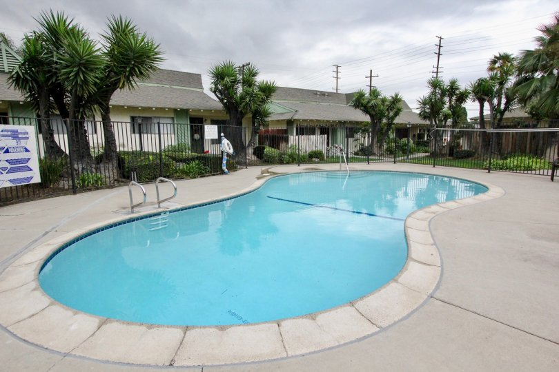 A pool shaped like the number 8 sits in the community area at the Bahamas condo community