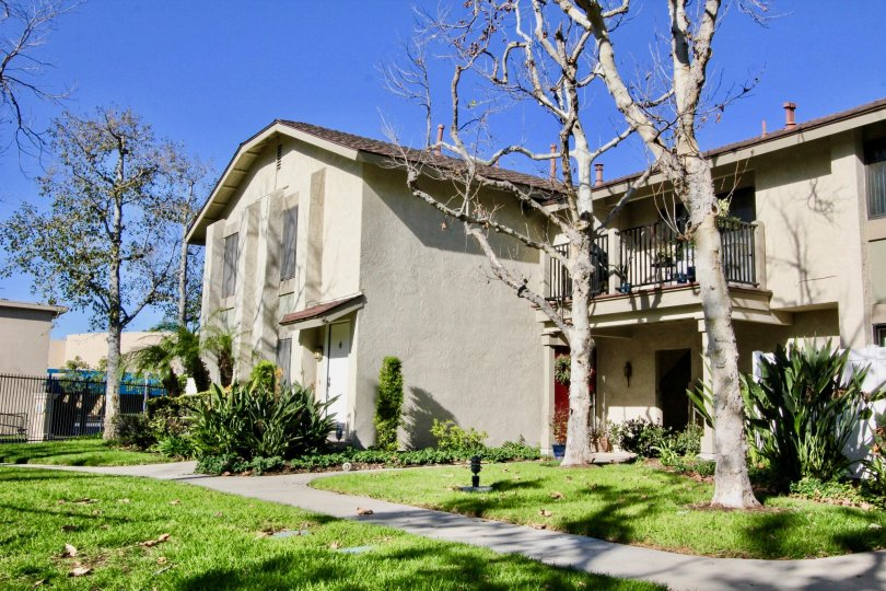 Fabulous view of green lawn with trees and balcony in Briarcliff Village of Tustin