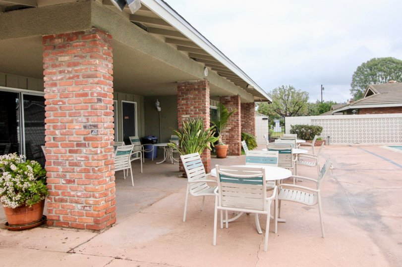 Brick columned patio at poolside of home in Broadmoor Park.