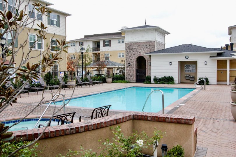 The swimming pool area in the multi family housing community of Cambridge Lane in Tustin California