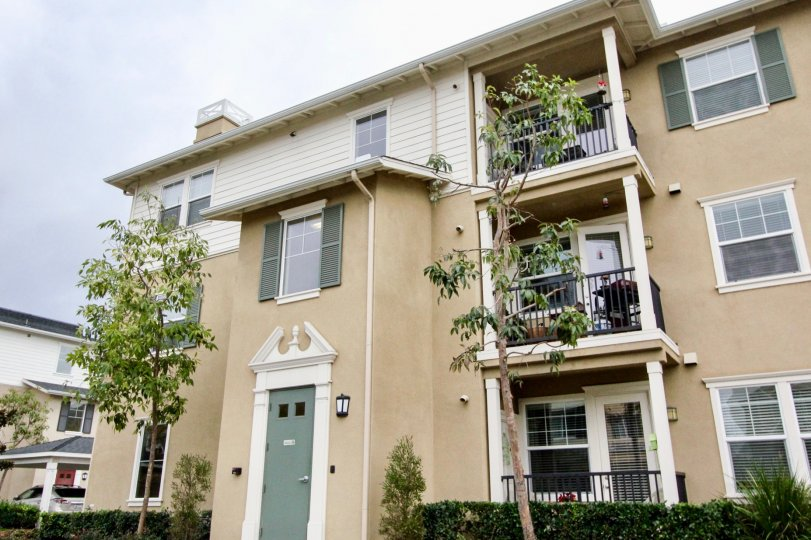 A three-storey townhouse with corner balconies in the Cambridge Lane community.