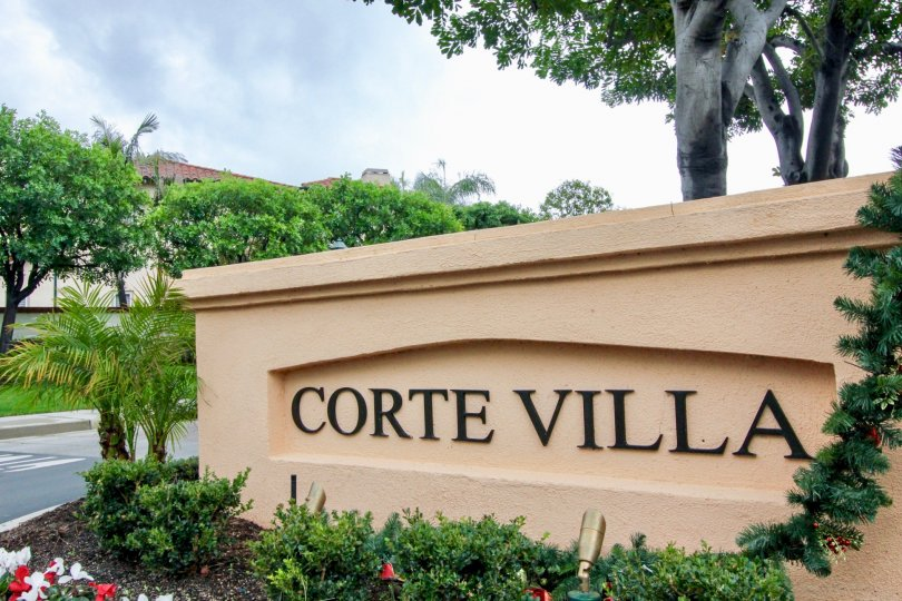"""Corte Villa"" is written in black on a sign at the Corte Villa condos"