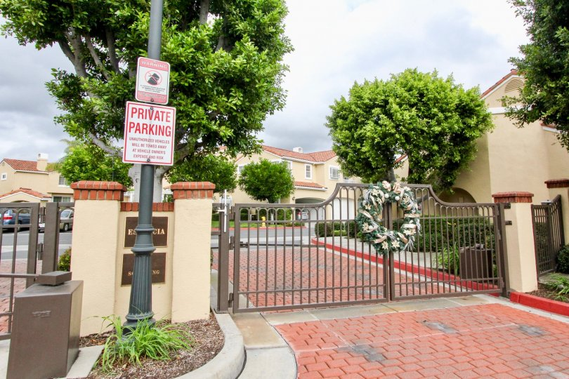 "A red and white sign reading ""Private Parking"" sits on a lamp post at the Estancia community"