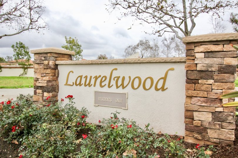 The sign for the Laurelwood community sits in between two stone pillars