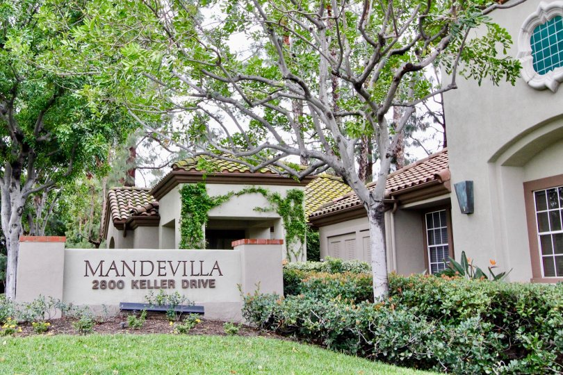 Multi family housing units with tiled roofs and garages in the community of Mandevilla in Tustin, California