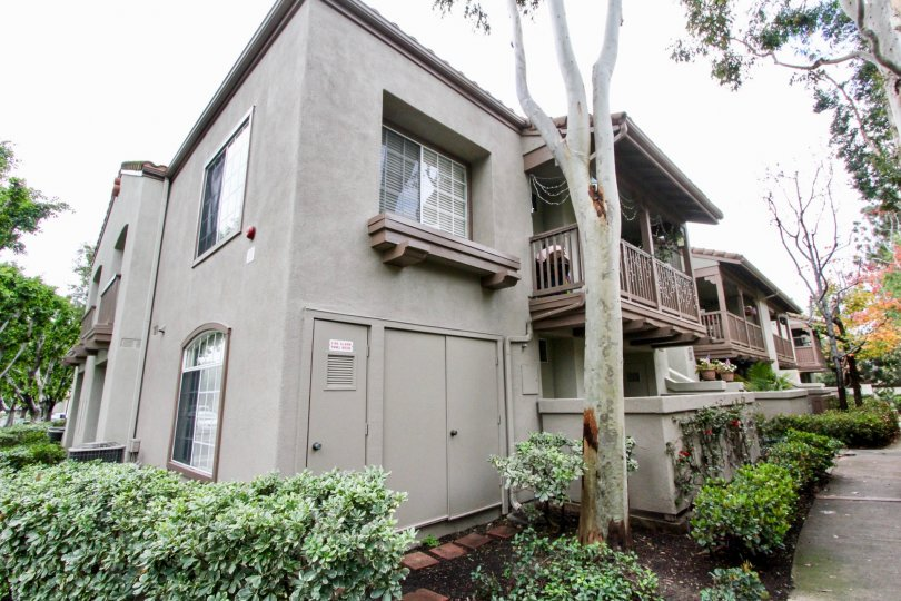 View of the residences located in Mandevilla in Tustin, California. Upper floor balconies and enclosed lower patios.