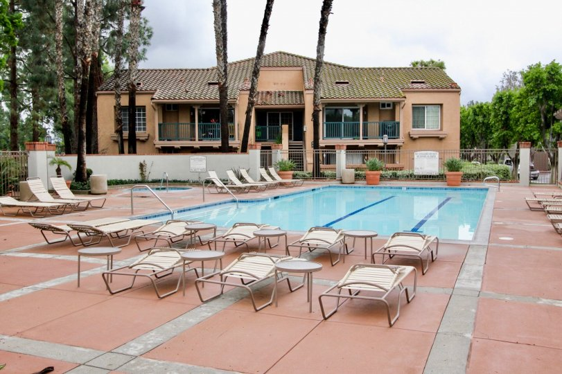 A public pool with terracotta tiles in the Mandevilla community.