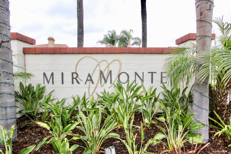 "A golden ""M"" sits behind the name ""Miramonte"" at the Miramonte community"