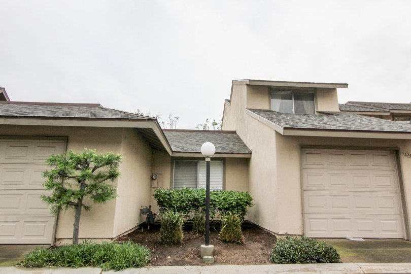 What appears to be an old condo house with a tan exterior and in Tustin