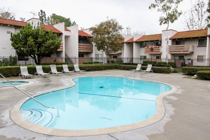 Beautiful swimming pool with sitting at centre of villas in Quail Meadows of Tustin