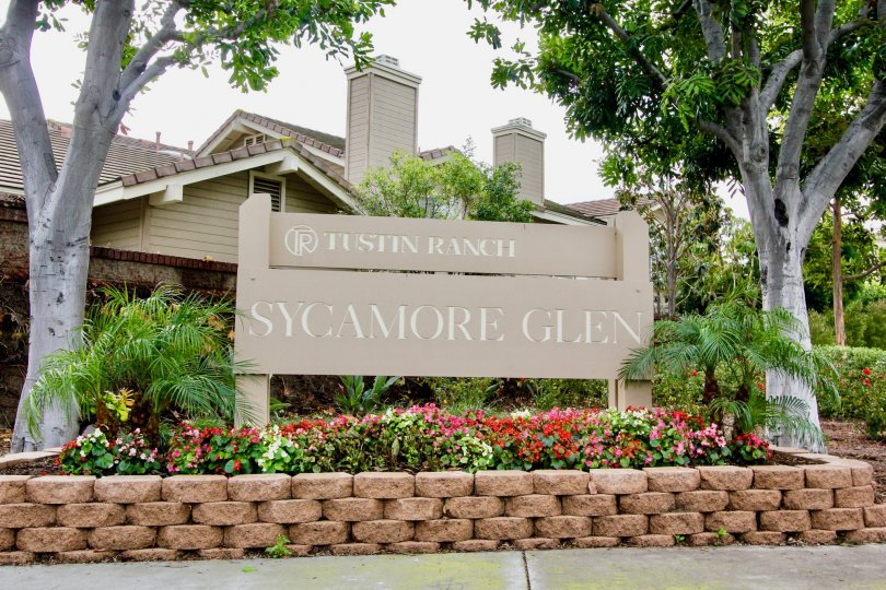 Welcome sigh surrounded by flowers in the Sycamore Glen community.