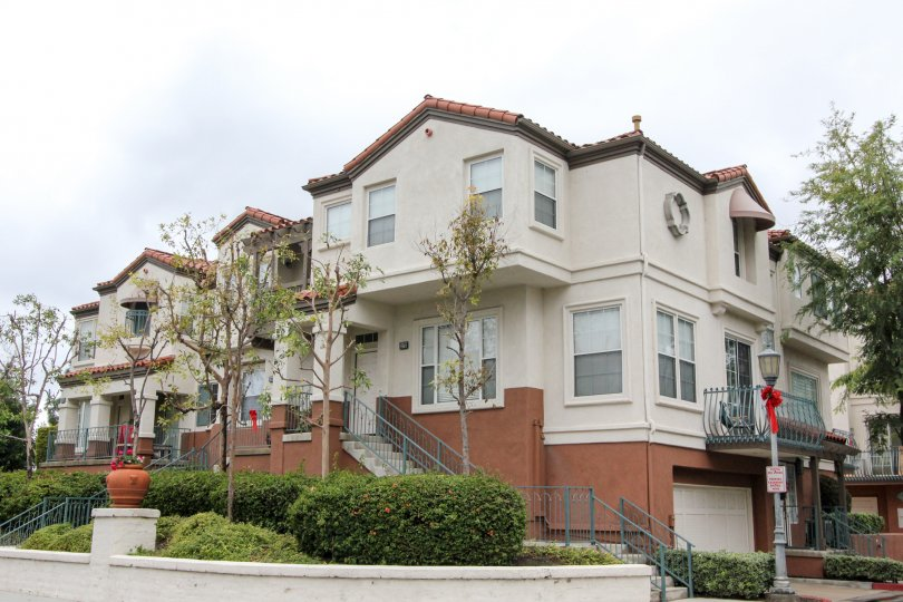 A three-storey townhouse painted in dark and light color in the Tustin Del Verde community.