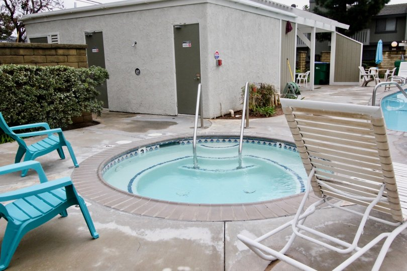 A circular baby pool in the pool area of a residential complex