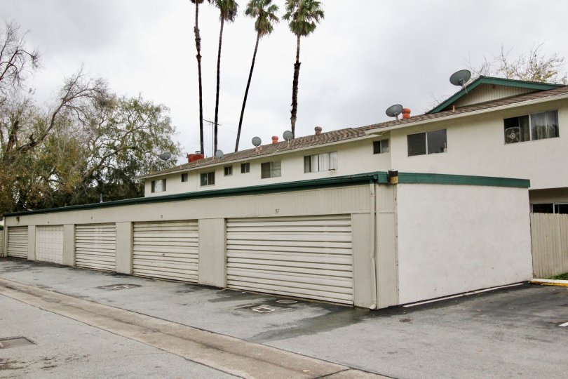 A multiple-car garage with green gutter in the Tustin Place community.