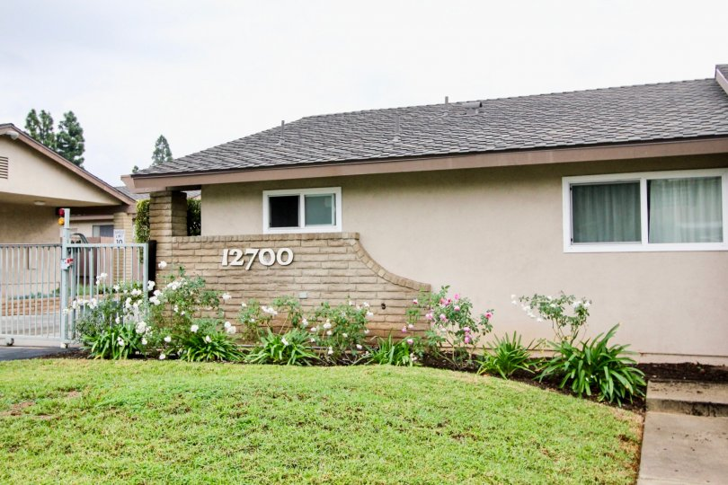 THE 12700 FLAT IN THE TUSTIN VERDES WITH THE FLOWER PLANTS, LAWN