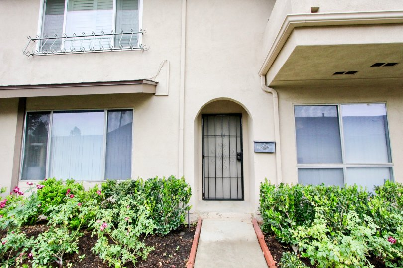 Security door access amoung mature, well-maintained landscaping at the Tustin Verdes community