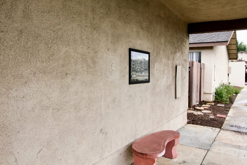 Picture Frame and bench on outside wall of a house in the Tustin Verdes neighborhood.