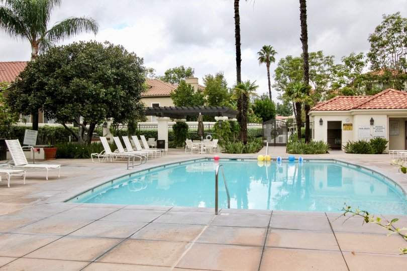 A public pool with tile paving in the Valencia community.