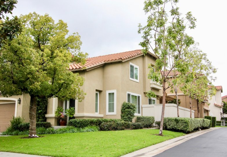 Valencia offers well maintained living options, including attached garages, and is surrounded by lush landscaping.
